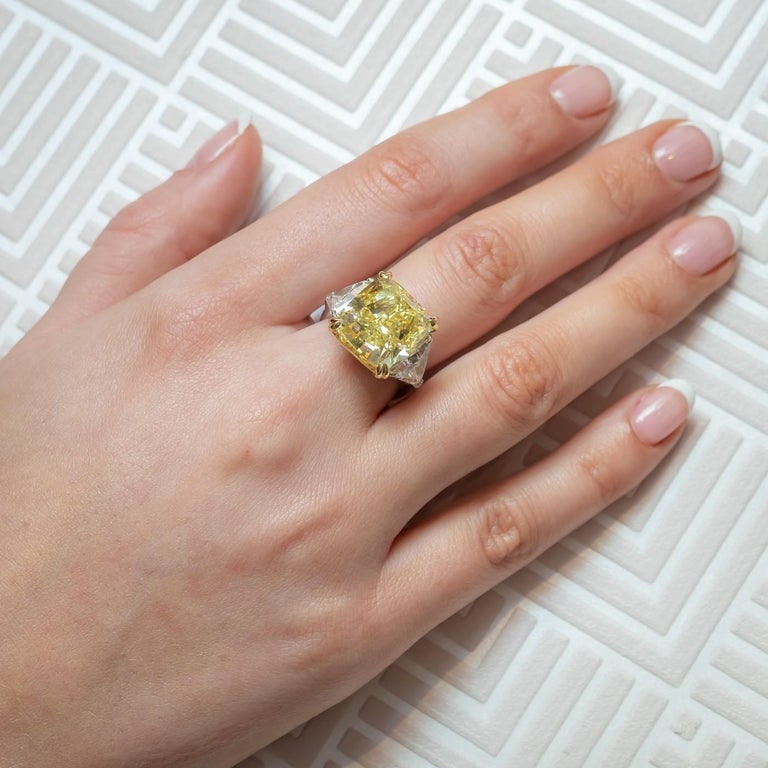A yellow diamond ring, set with a 14.51ct fancy intense yellow colour, VS1 clarity, cushion shaped, modified brilliant-cut diamond, measuring 13.45 x 13.01 x 9.00mm, accompanied by GIA certificate 14450855, in a four claw, yellow gold setting,