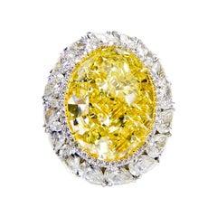 Fancy Intense Yellow Oval Diamond Ring Set with Pear Shape Diamonds
