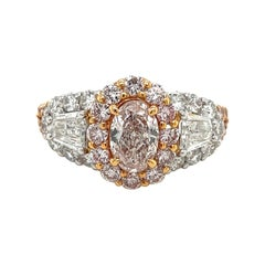 Fancy Light Pink Diamond Ring with White Diamonds Set in Rose Gold and Platinum