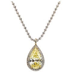 Fancy Light Yellow Diamond 4.49 Carat Pendant With 2.82 Carat Diamonds