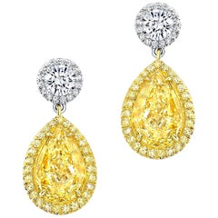 Fancy Light Yellow Diamond Earrings 4.03 Carat Pear Shapes