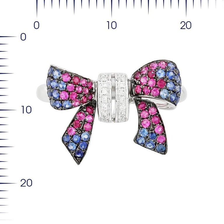 White Gold 14K Ring   Diamond 18-RND-0,04-G/VS1A Pink Sapphire 22-0,15ct Ruby 14-0,1ct Sapphire 33-0,27ct  Weight 3,38 grams Size 17  With a heritage of ancient fine Swiss jewelry traditions, NATKINA is a Geneva based jewellery brand, which creates