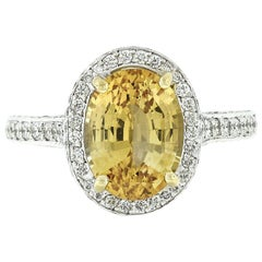 Fancy Platinum 5.6 Carat GIA Oval Yellow Sapphire and Diamond Cocktail Ring
