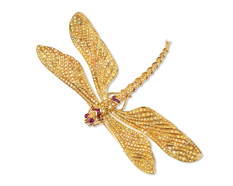 Enveloped in a sea of 60.26 carats of fancy vivid yellow diamonds is this tour de force of jewelry craftsmanship from the collaboration of jewelry legends Fred Leighton and Carvin French. Made for Patricia Kluge, then-wife of the billionaire founder