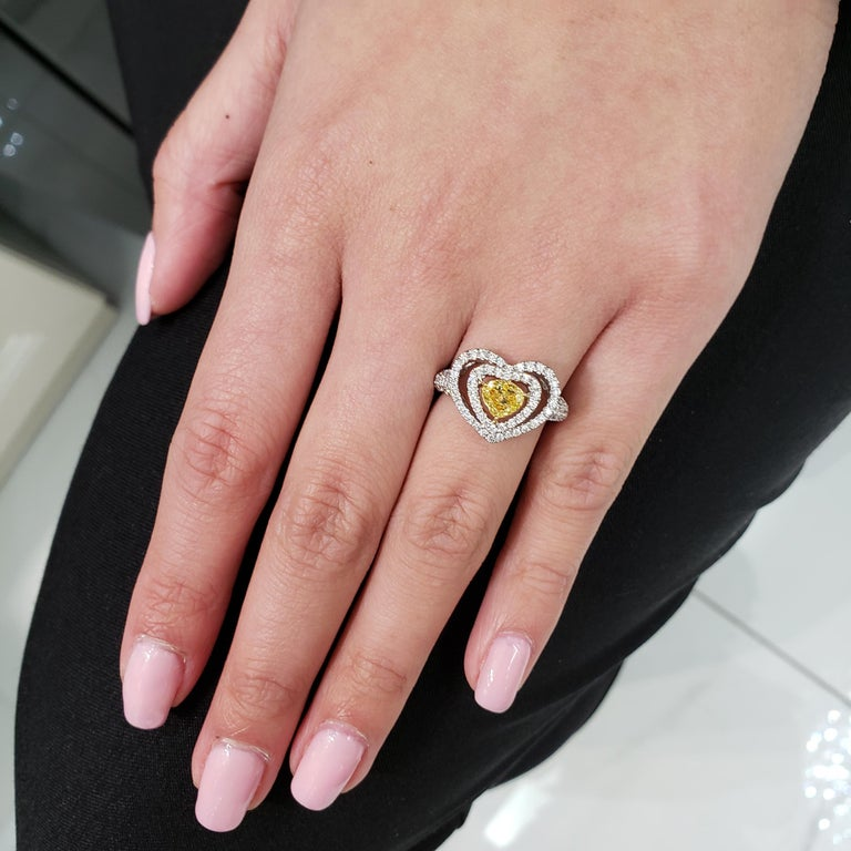 Contemporary Fancy Yellow Diamond Double Halo Heart Shape Engagement Ring For Sale