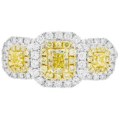 Fancy Yellow Diamond Double Halo Two-Color Gold Three-Stone Ring
