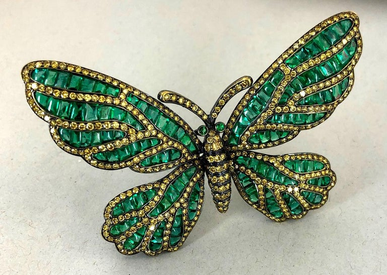 Black gold butterfly brooch, set with fancy yellow diamond and emerald. Dimensions approx. 2