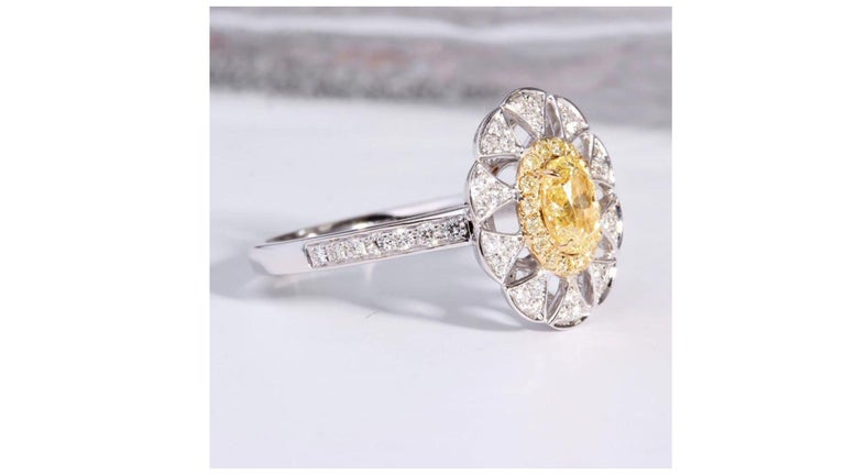 Contemporary Fancy Yellow Diamond Ring 18 Karat White Gold For Sale