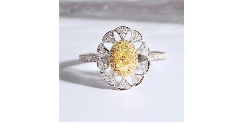 Oval Cut Fancy Yellow Diamond Ring 18 Karat White Gold For Sale
