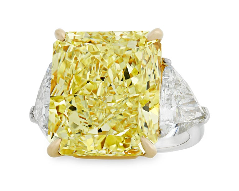 This monumental 20.28-carat natural fancy yellow diamond ranks among the rarest and most coveted of all gemstones. The rare stone is certified by the Gemological Institute of America (GIA) as natural fancy yellow, and its exceptional hue displays
