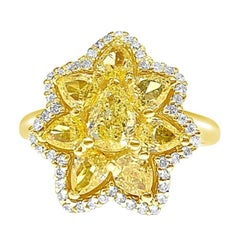 Fancy Yellow Pear Shape and White Round Brilliant Diamond Ring in 18 Karat