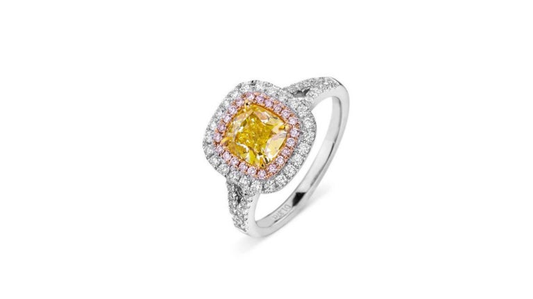 This is a  1.37-Carat Cushion Cut Fancy Yellow VS2  set in  18K Gold with 52 Brilliant G-H VS Natural Diamonds Totaling 0.36 Carats and 22 Brilliant Fancy Pink VS Diamonds with a GIA Certificate .  Very unique and if you are looking for anything