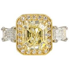 Fancy Yellow Radiant Cut Three-Stone Halo Set Diamond Engagement Ring