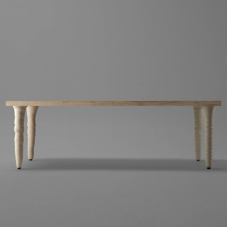 The fang table is a table with legs made of porcelain stoneware. The legs have been hand-turned. The legs are always purposefully different and imperfect.   Xavier Mañosa (Barcelona, 1981) potter, artist and designer. He inherited the artisanal
