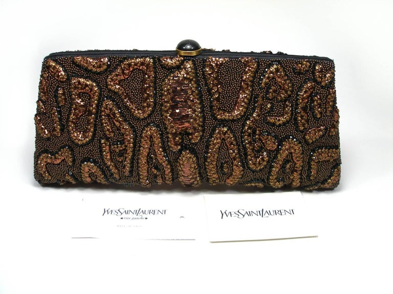 Fantastic Era Tom Ford for Yves Saint Laurent  Beaded Leather Brown / black and gold  Brand tag inside YSL Rive Gauche Inside in black satin Dimensions : L 28.5 x H 12 x P 3.5 cm Please note : small glitter restoration in the centre Good