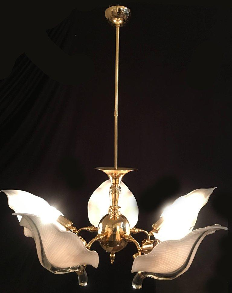 Great and wonderfully precious Murano chandelier in handblown glass leaves and gold-plated hardware by the famous master designer Franco Luce. Also available a pair of sconces.