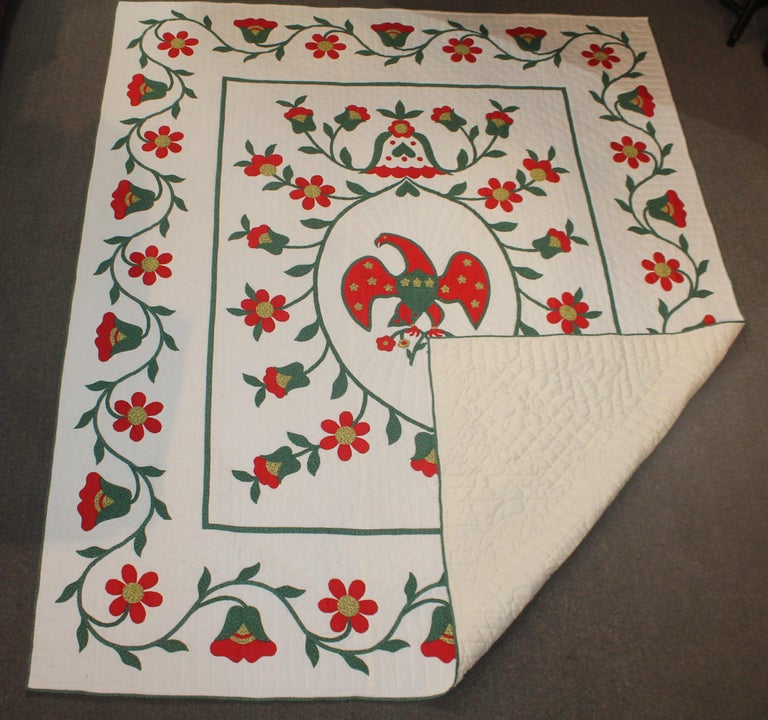 Fantastic eagle applique quilt with a wonderful tulip and vine border. The condition is very good. It is amazing and graphic. This quilt is from Lancaster County, Pennsylvania.