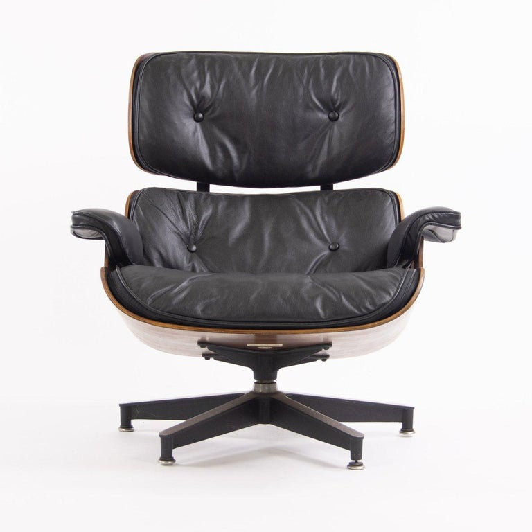 Gorgeous Herman Miller Eames lounge chair and ottoman. Luxurious rosewood shells and black leather adorn this American modern design Classic. Signed and guaranteed authentic. Maintains original Herman Miller medallion and paper patent label.