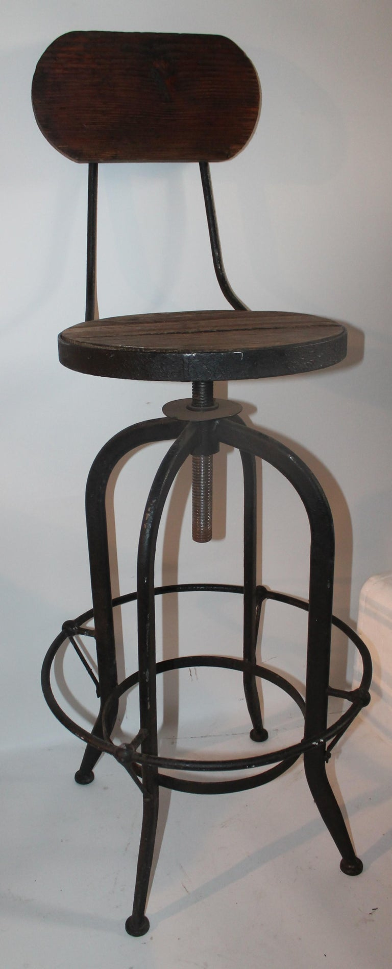 This cool rustic architect writing stool or store counter stool is in great condition and swivels too. It can be adjusted up or down.
