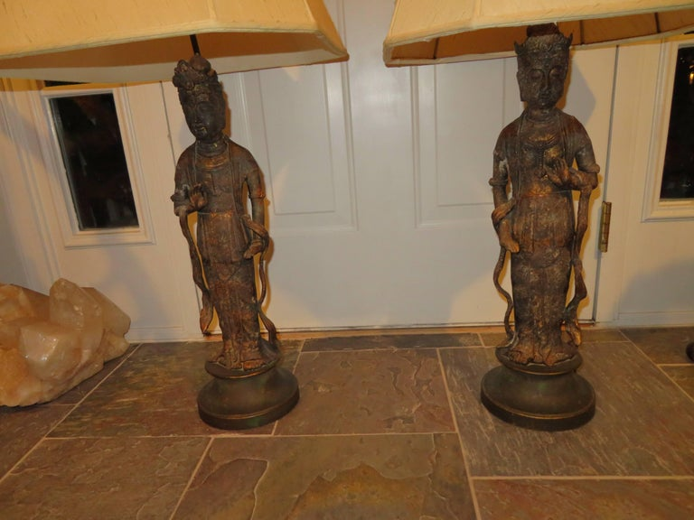 Fantastic pair of James Mont Style Asian figural Buddha Lamps. This pair has a wonderful aged patina and are in very nice vintage condition.