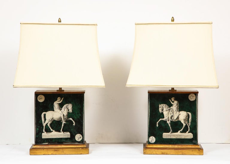 Fantastic pair of midcentury Italian green molded glass lamps, attributed to Piero Fornasetti, circa 1950, Milan.