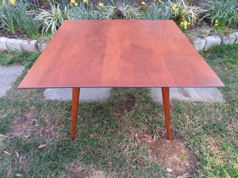 Fantastic Paul McCobb for Planner Group mid century square coffee table. This piece is in very nice condition with the top being newly refinished. Coffee table measures: 32 wide x 32 deep x 20.25 high.
