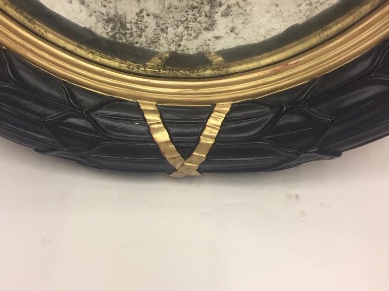 Hollywood Regency Fantastic Round Ebonized and Gilt Convex Mirror For Sale