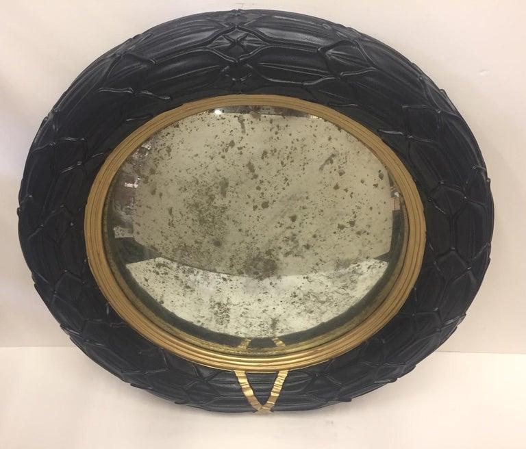 Cast Fantastic Round Ebonized and Gilt Convex Mirror For Sale