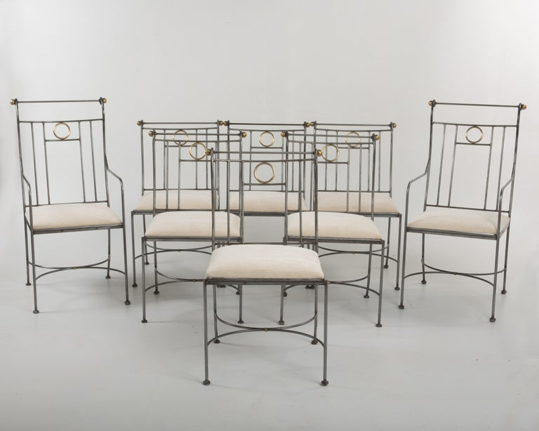 Very elegant mixed metal set of 8 dining chairs having a chic intermingling of steel and brass with an updated modern twist on neoclassical design, newly upholstered in a neutral cream cotton cut corduroy. Measures: 2 armchairs are 40 H, 20 W, 18 D,