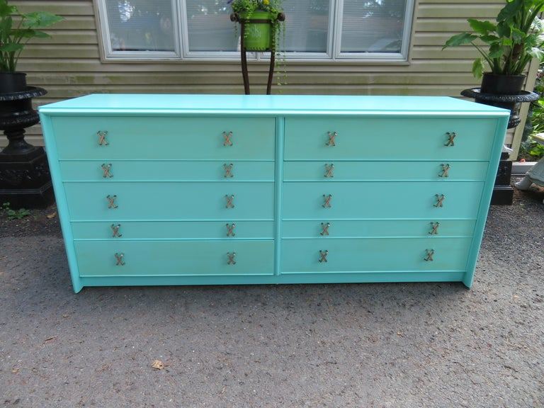 Fantastic Tiffany box blue Paul Frankl X-pull dresser credenza. This piece was restored by the original owner about 10 years ago and still looks great. The said they had it professionally repainted with this Tiffany box blue color and is gorgeous in