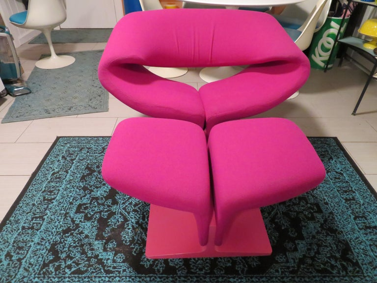 This iconic and innovative Ribbon chair and matching ottoman designed by Pierre Paulin for Artifort is a stunning organic form of contoured tubular steel that is ergonomically designed for comfort. This vintage set retains their original Barbie pink