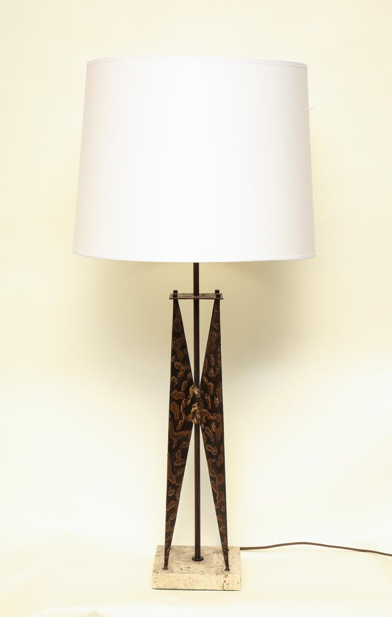 A Fantoni table lamp the sculptural form handcrafted of iron with dripped solder application marble base, Italy, 1950s. Shade not included.