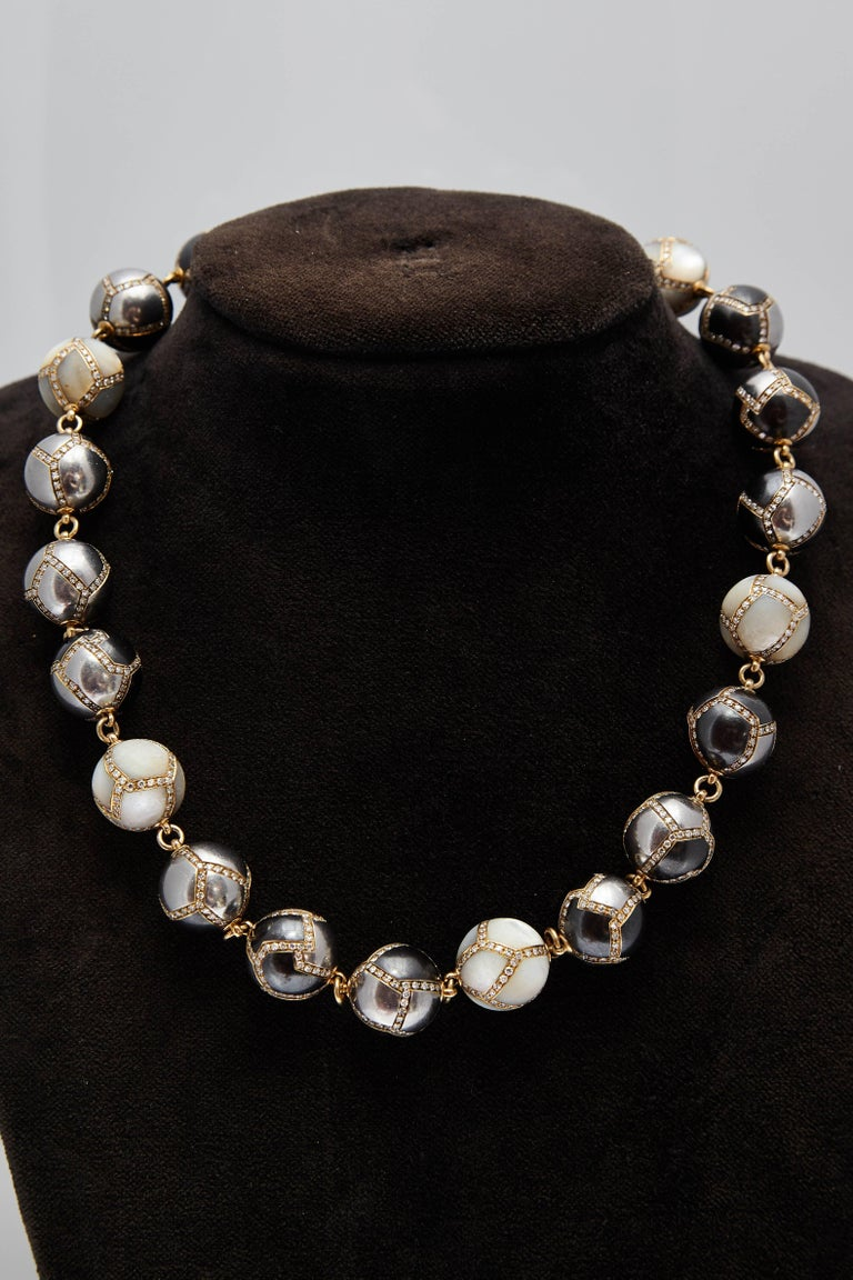 Faraone necklace in 18kt yellow gold with hematite and diamonds spheres. Made in Italy, circa 1970s.