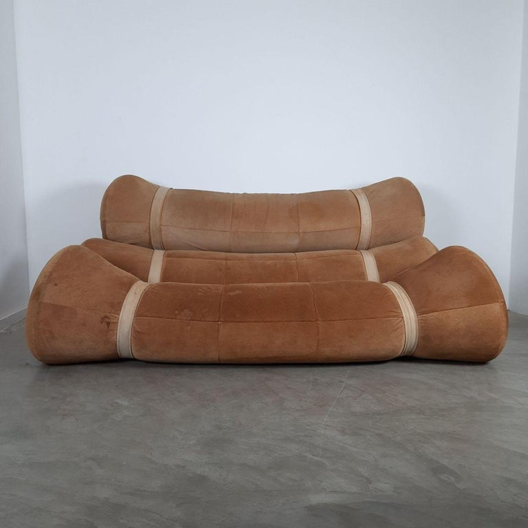 Extremely comfortable vintage Fardos sofa by the Brazilian designer Ricardo Fasanello. This is his first creation made in 1968. It consists of three large rolls of foam held together by straps on painted metal base structure. Upholstered with brown