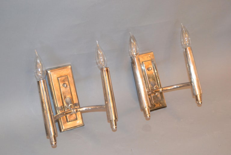 A pair of Farlane double sconces in polished silver designed by Thomas O' Brien and manufactured by Visual Comfort. Each sconce uses 2 candelabra light bulbs with max. 40 watts.