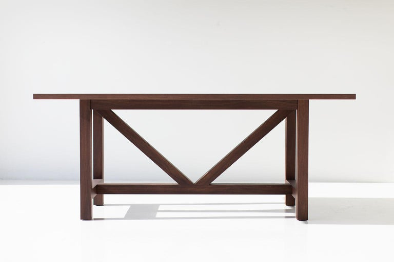 Farm table walnut dining table for Bertu Home.  This walnut farm table is made in the heart of Ohio with locally sourced wood. We use the table both as a dining table or desk. Each table is handmade with solid walnut and finished with a beautiful