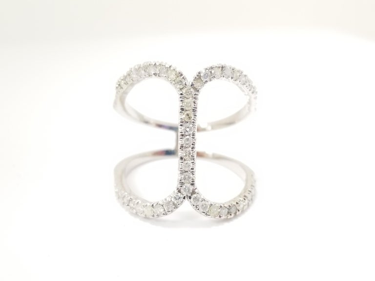 Prong-Set Diamond Cross Ring 0.54 cttw Average Color/Clarity I Color SI-I. Ring Size 6.5 Brilliant prong-set round diamonds intersect each other in a cross design and look stunning. Crafted in 14k White gold, this ring exudes understated style and