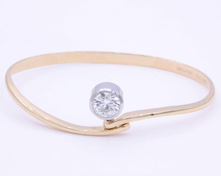 This 18k rose bangle features one round brilliant weighing 1.73 carats, in a platinum bezel. Great for stacking or wearing alone.  Can be customize to a birthstone or gem of choice.