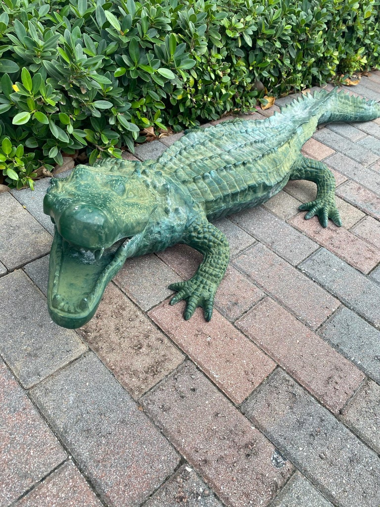 Very realistic alligator metal sculpture.