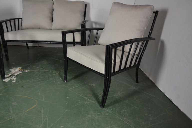 1970s faux-bamboo aluminum sofa set. The seats are foam covered in new light gray color fabric. The pair of club chairs are 29