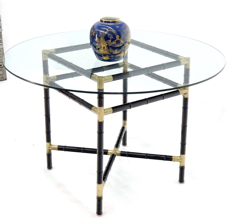 Mid-Century Modern Art Deco era 5 pieces dining room set consisting of four chairs and a round glass top table. The wooden parts have beautiful original vintage finish and precisely interlock with the help of sharp looking brass fittings. Chairs