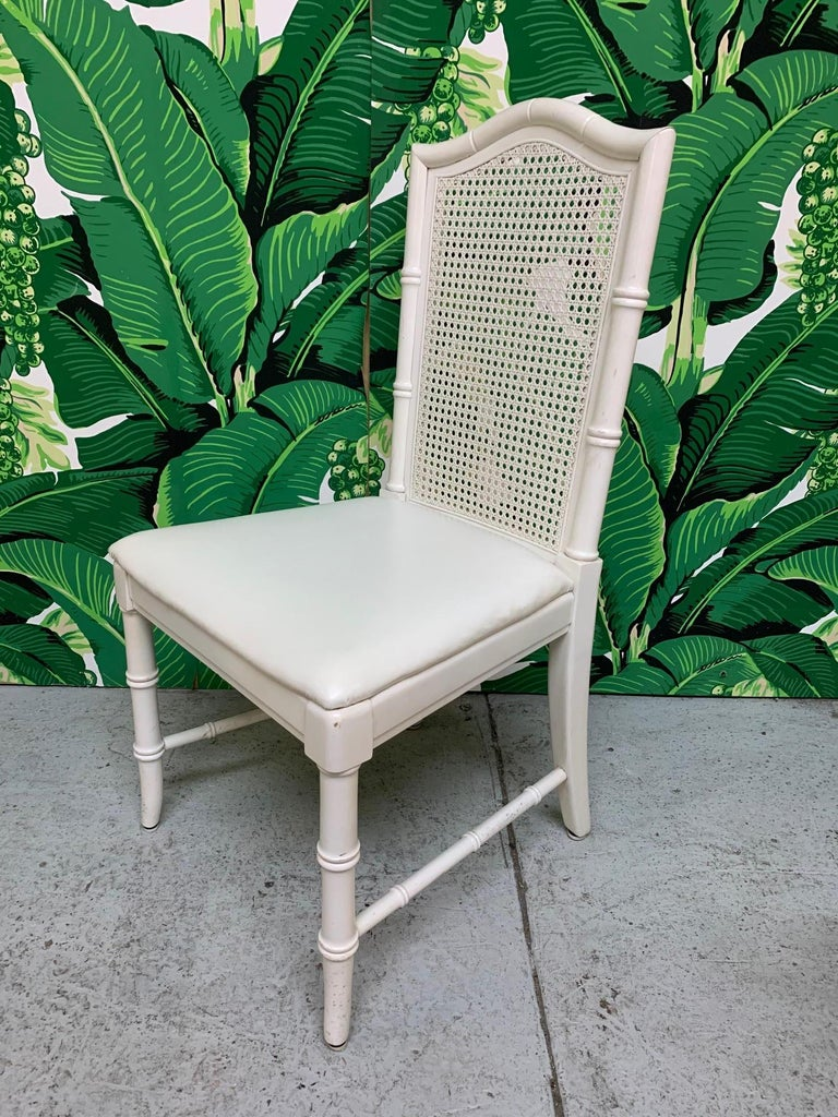 Set of six vintage Thomasville dining chairs feature cane backs and faux bamboo detailing. Very good condition with minor imperfections consistent with age.