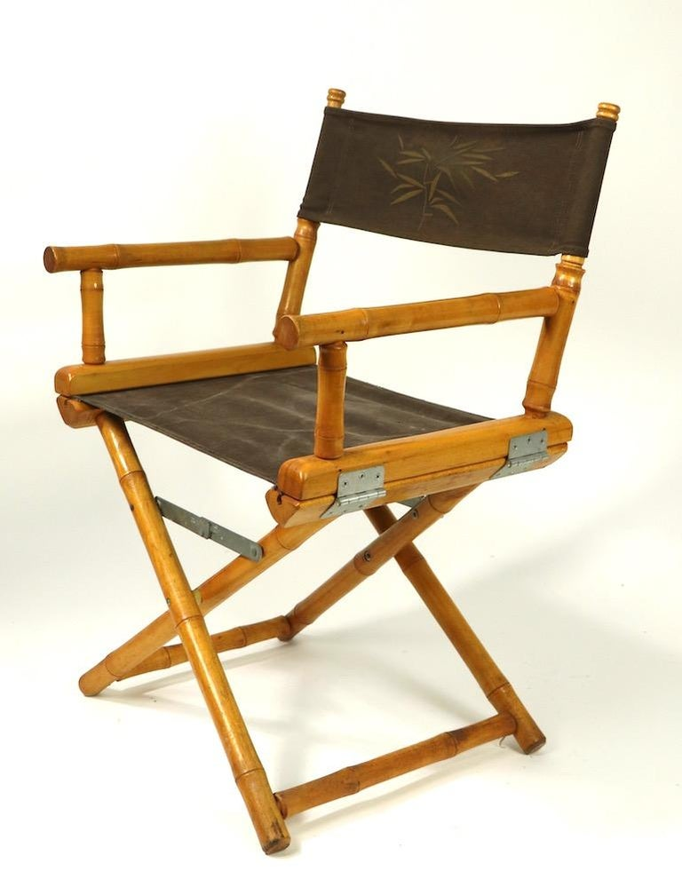 Stylish folding directors chair, by Telescope Furniture. This example has a turned wood faux bamboo frame, and stenciled bamboo motif canvass backrest sling. The canvass seat shows cosmetic wear, normal and consistent with age. Measures: Total H