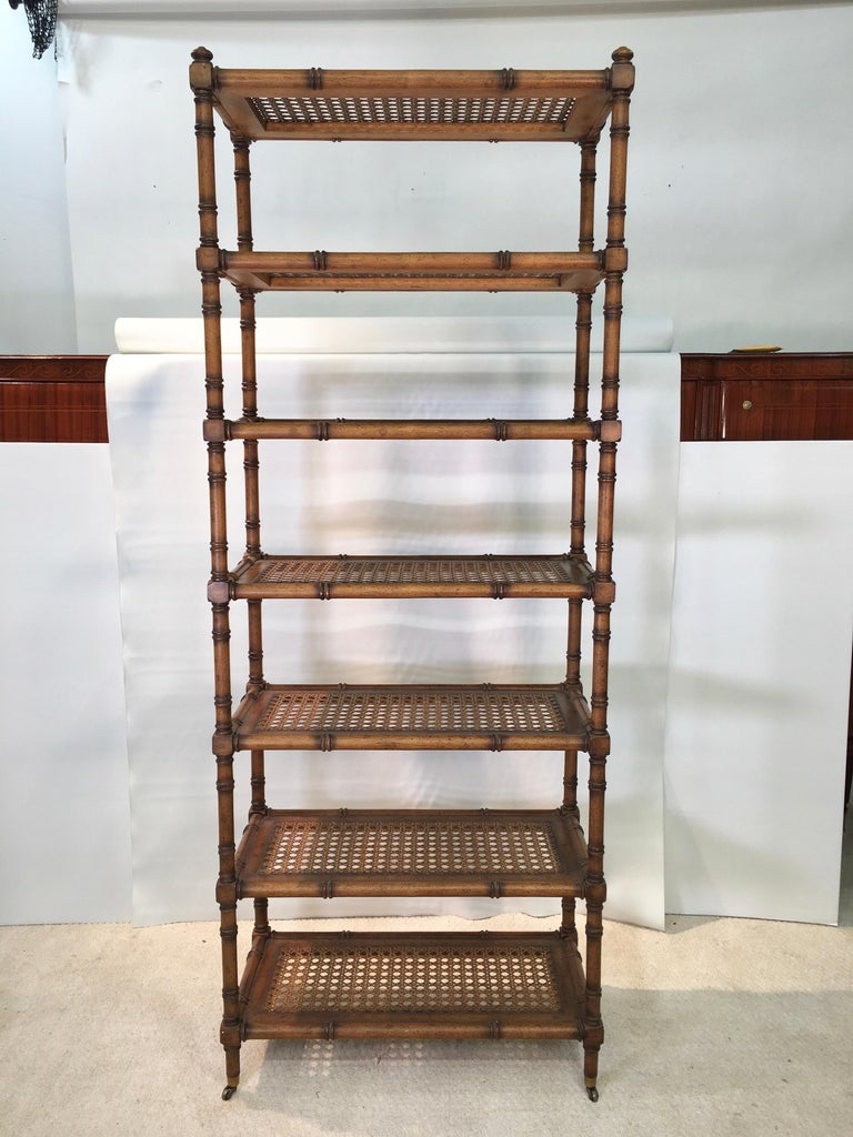 Hollywood Regency Faux Bamboo Étagère with Caned Shelves For Sale