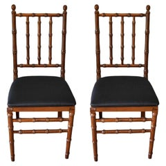 Faux Bamboo Wood Folding Chairs with Black Upholstered Seats, a Pair