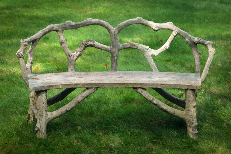 Faux bois bench with naturalistic design.