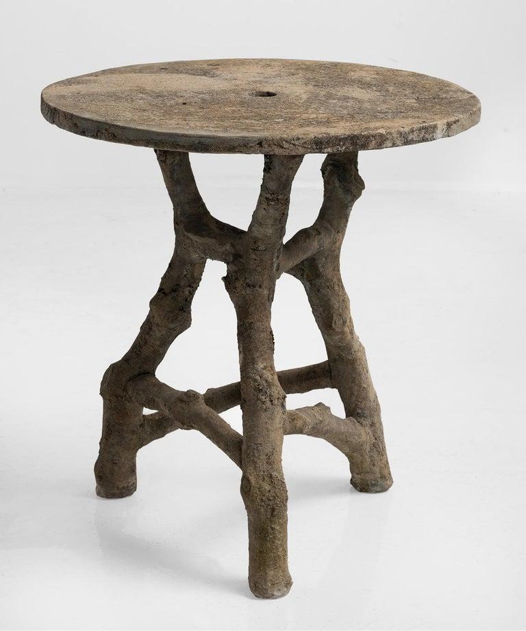 Faux bois table, France, circa 1950.  Hand-sculpted concrete table with unique form.
