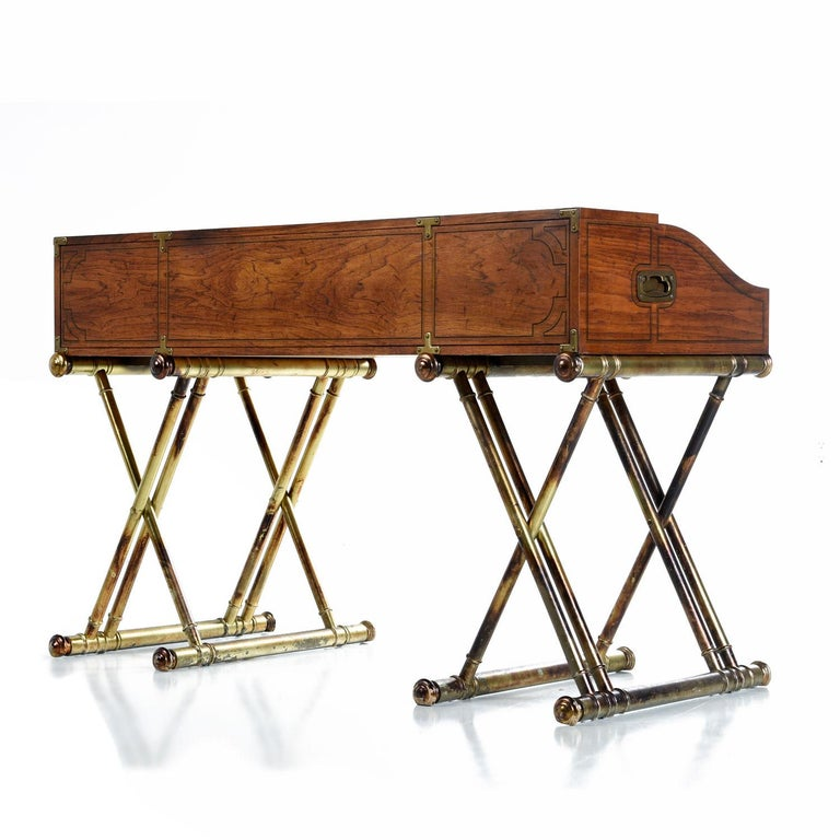 This is not a 19th century British Campaign roll top desk. It's way better. Why? Because it was made in 1970s in America by Drexel with all the bizarre, stately flamboyance and none of the pesky practicality that real Campaign furniture comes with.