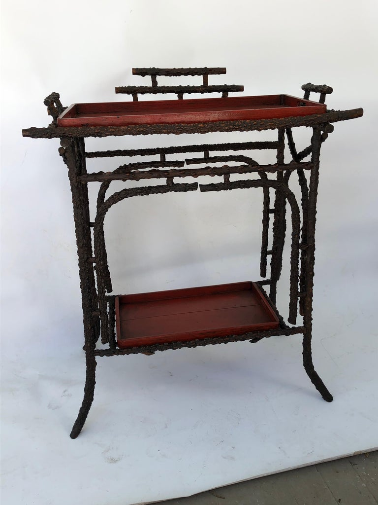 Faux Burr root wood stand with two Nagara Nuri style red with black undertone lacquer trays. Oriental style stand. Makes a lovely bar. There is a crack in the top