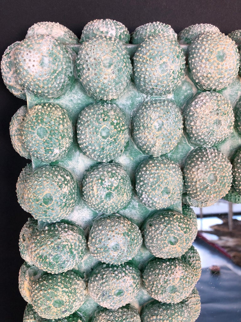 Faux coral mirror in a sea green color. Mixed-media composition made to look like coral.